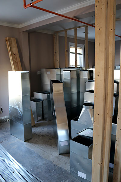 Pre-fabricated ductwork awaits installation at 1212 Community House Apartments.