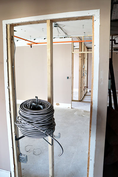 Electrical conduit sits on a spool awaiting installation at 1212 Community House Apartments